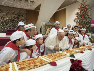 Pope marks 81st birthday with extra-long pizza