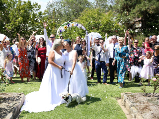 Lesbian couples tie the knot in Australia's first same-sex weddings