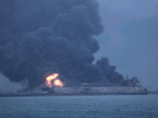 Oil tanker burning off China's coast could explode, officials warn