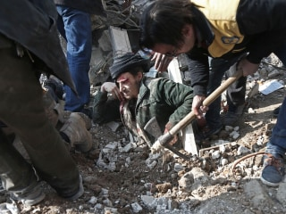 Syrians pulled from rubble of besieged city outside Damascus