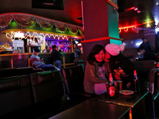 Bhutan embraces jeans, TV, cellphones, dance bars