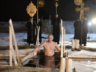 Shirtless Vladimir Putin takes dip in icy Russian lake