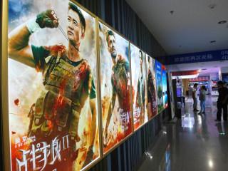 China backs boasts of 'new era' with patriotic movies, rap music