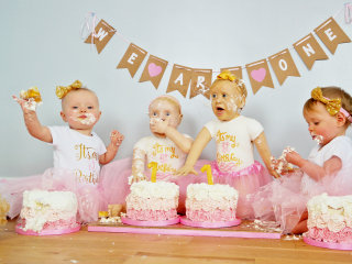 Seeing double! These twin girls look exactly like their life-size birthday cakes