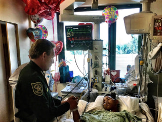 Florida police visit teen Anthony Borges, who was wounded in school shooting