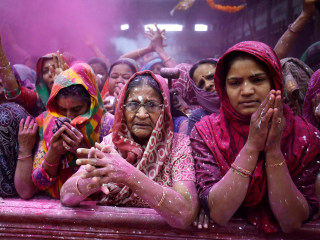 Colored powder flies as Hindus celebrate Holi