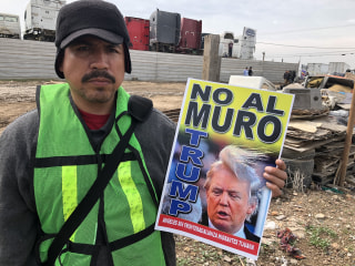 Critics of Trump's border wall shout opposition from Tijuana