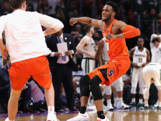 Syracuse pulls off stunning upset over Michigan St. to advance to Sweet 16