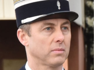 French police officer who traded places with hostage during terror attack dies