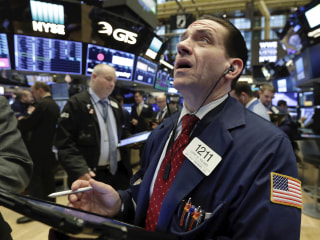 Markets sink on investor fear of trade war, damage to tech sector