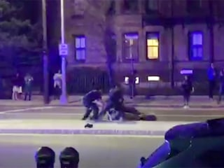 Video shows police punching black Harvard student during arrest