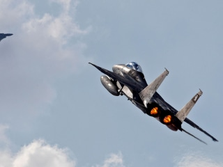 Israel warns Iran on military buildup in Syria, won't send jets to U.S. drill