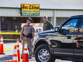 Deputies shot through restaurant window; sheriff blames hate