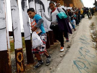 Border fills to capacity as caravan of migrants arrives, officials say