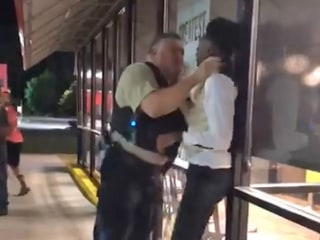 Black man choked by police officer outside Waffle House was subject of gay slurs, lawyers claim
