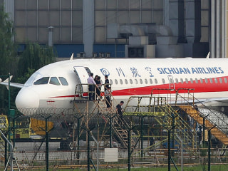 Sichuan Airlines co-pilot sucked halfway out cockpit window, pilot says