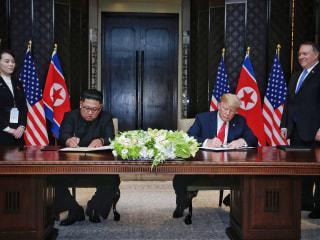 Trump, Kim sign agreement after North Korea summit; war games put on hold