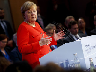 Merkel calls out Trump over Paris accord, renews commitment to fight climate change