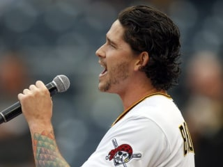 This MLB pitcher didn't play last night, but he did sing the National Anthem