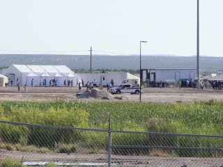 Mothers wait in agony in immigration detention to see children again
