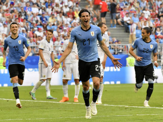 Uruguay tops Russia & Group A with perfect record