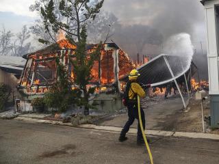 Destructive wildfires race across the U.S. West