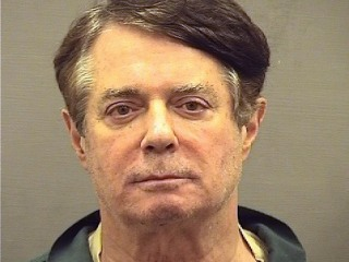 Paul Manafort sports jailhouse jumpsuit, scruff at new lockup