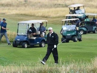 Trump arrives in Scotland for quiet weekend of golf after tumultuous week on world stage