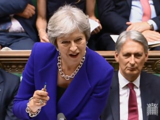 Theresa May survives key Brexit votes but her government is accused of 'cheating'