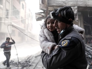 Israel evacuates stranded Syrian White Helmets in 'international effort' as regime forces close in