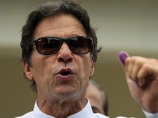 Pakistan election marred by suicide bomb as Imran Khan seeks power
