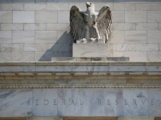 Fed holds rates steady, sees economy on track