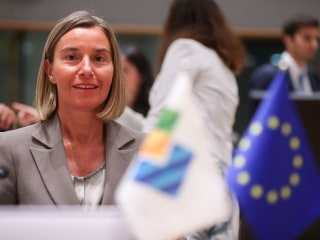 E.U. threatens firms that stop doing business with Iran over Trump sanctions