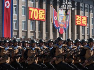 North Korea marks 70th anniversary with huge parade, but holds back on advanced missiles