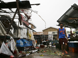 Powerful typhoon kills at least 12 in Philippines, heads toward China
