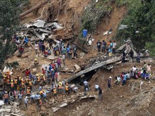 Typhoon Mangkhut triggers landslide in Philippines, burying dozens in chapel