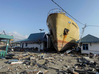 Rescues and mass graves: Scenes of devastation in hard-hit Indonesian city