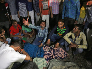 Several dozen dead after train runs over crowd in India during religious celebration