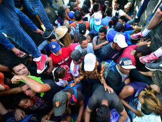 As migrant caravan continues north, some debate staying or moving forward