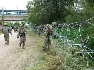 Sent by Trump, soldiers arrive at border as migrant caravan in Mexico pushes north