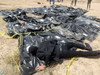 Islamic State put up to 12,000 people in mass graves, U.N. says