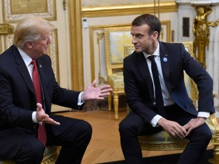 Trump and Macron paper over differences in Paris meeting