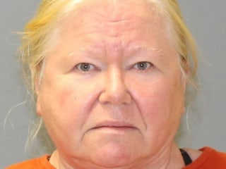New Jersey woman charged after 44 dead dogs found in plastic bags stored in her freezers