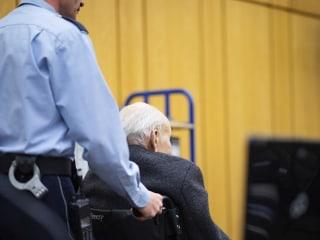 Former Nazi guard testifies he wasn't involved in killings