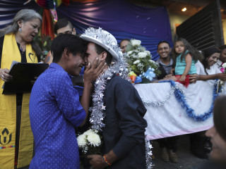 'Dream come true': Migrant caravan LGBTQ couples celebrate mass wedding