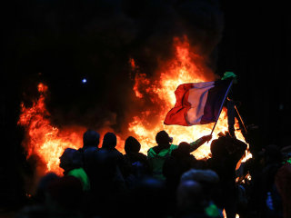 France backs down, delays tax increases after Paris riots