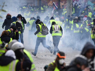 Macron to address France after protests see 135,000 on streets