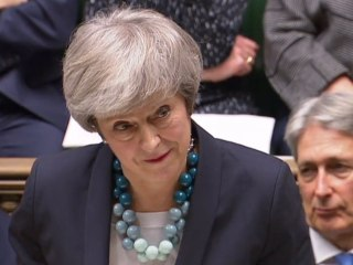 Britain's Theresa May delays parliamentary vote on Brexit