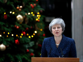 Prime Minister Theresa May faces no-confidence vote amid Brexit chaos