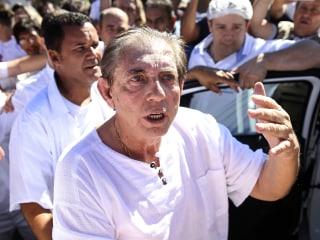 Brazil faith healer accused of sexual abuse ruled a fugitive